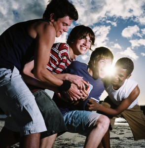 Group of Young Men Wrestling Playfully --- Image by © Royalty-Free/Corbis